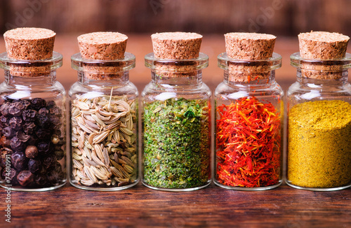spices in bottles - 74610991