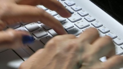 Woman Hand is Writing on Notebook Computer