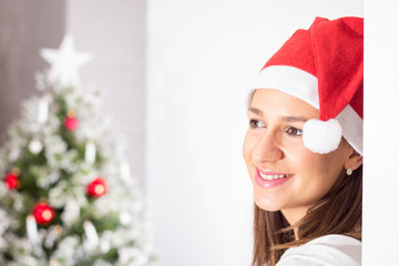 Beautiful woman with Santa hat posing