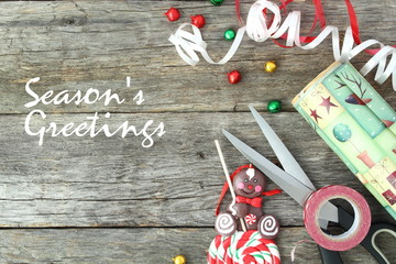 Christmas concept. Material to wrap a gift: Season's greetings