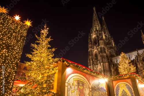 cologne cathedral with christmas market - 74612129