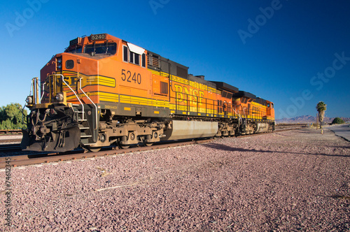 Leinwandbild Motiv BNSF Freight Train Locomotives No. 5240 in the desert