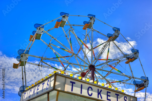 Foto op Canvas Carnaval Purchase a ticket before riding the Ferris wheel