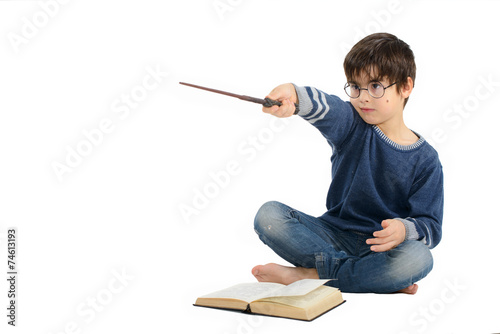 Little cute boy is reading a book and imagining himself a hero - 74613193