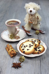 Christmas composition: cup of coffee, biscuits and a teddy bear