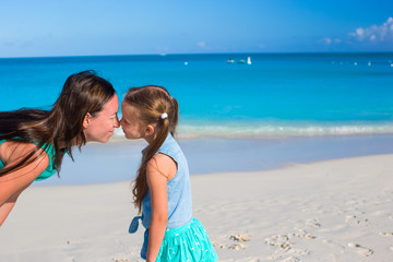 Mother with little girl have fun on summer vacation