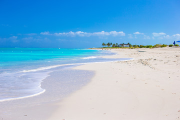 White sandy beach with turquoise water at perfect island