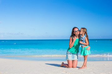 Young mother and adorable little daughter enjoy summer vacation