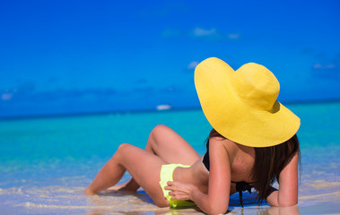 Young woman in yellow hat during caribbean vacation