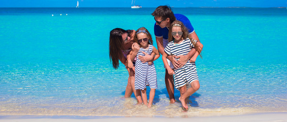 Family of four with two kids during beach vacation
