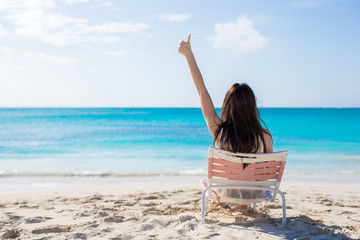 Young woman in beach chair during her tropical vacation