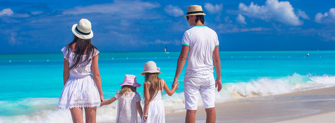 Family of four with two kids during beach summer vacation