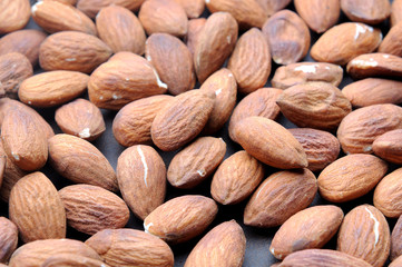 roasted almonds on wooden background