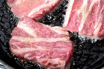 roasted meat on iron pan