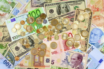 Background from dollars and euro bills. Coins on paper bills