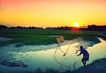 Local life in evening time (a man is catching fish)
