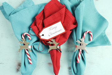 Merry Christmas table place setting red and aqua blue napkins