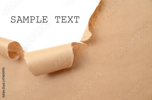 Leinwandbild Motiv Loch im Packpapier