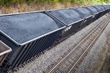 Line of Coal Freight Cars On Train Track - 74617554