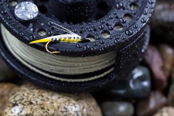 Single Trout Fishing Fly on Reel