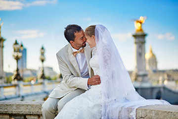 Just married couple on the Alexandre III bridge