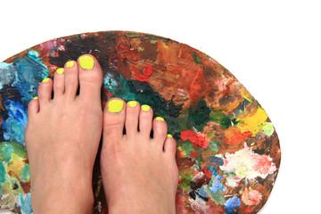women feet (pedicure)  with color palette