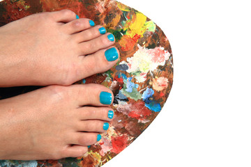 women feet (pedicure)  with color palette