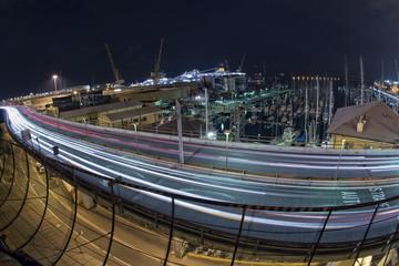 Car light tracks on Genoa Flyover at night