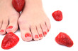 women feet (pedicure) with  strawberries