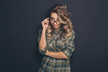 Portrait of a young beautiful blond-haired wearing trendy glasse