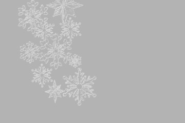 Textured snowflakes on gray background