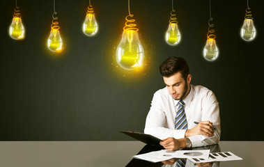 Businessman with idea bulbs