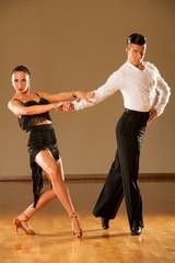 latino dance couple in action - dancing wild samba