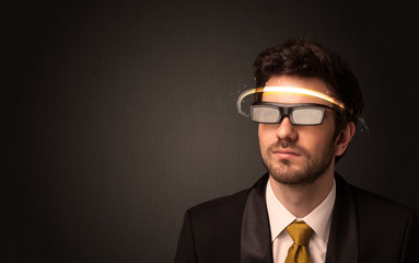 Handsome man looking with futuristic high tech glasses