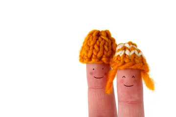 Smiling couple with hand knitted wool hats - isolated