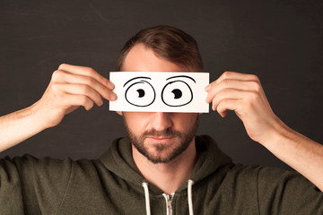 Funny man looking with hand drawn paper eyes