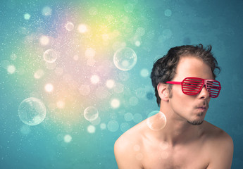 Young man with sunglasses and bokeh colourful lights