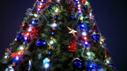 Christmas tree and decorations on night background. Shift motion