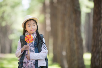 Asian girl eating a colorful candy