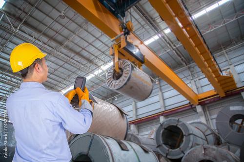 Staande foto Industrial geb. The engineer control the crane