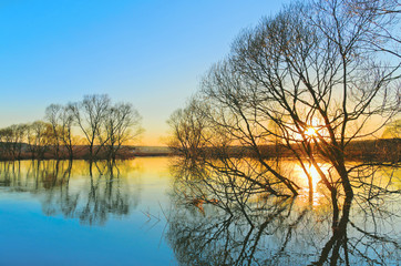 Spring sunset. Flood of River Protva. Kaluga region. Russia