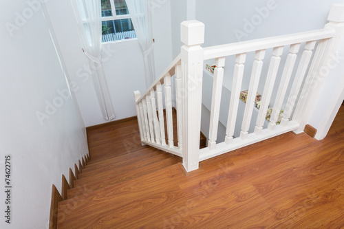 wooden staircase made from laminate wood in white modern house - 74622715