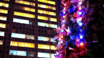 evening winter christmas tree and business center in the street