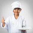 Little asian girl chef showing the empty white plate