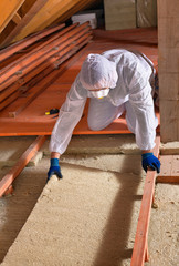 Man laying thermal insulation layer - wearing protective clothin