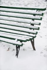 Snowed wooden bench