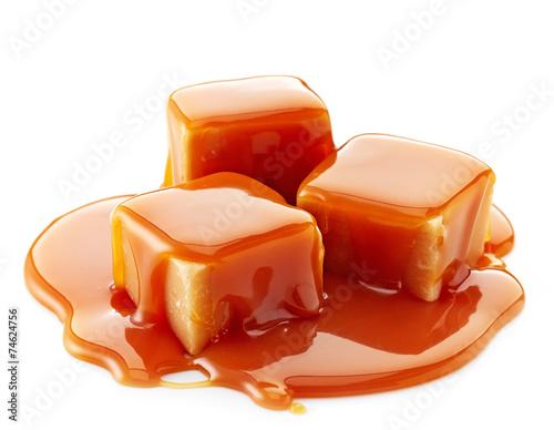 Deurstickers Snoepjes caramel candies and caramel sauce