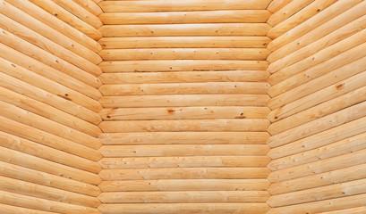 Three wall made of wooden logs closeup.