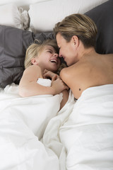 Mother and Daughter bonding in bed
