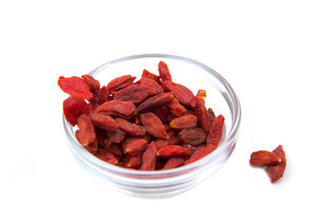 Goji berries on bowl on white background